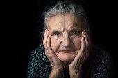 Portrait of a nostalgic elderly woman. Evoking the past.