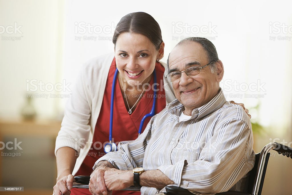 Portrait of a nurse and an elderly man smiling stock photo
