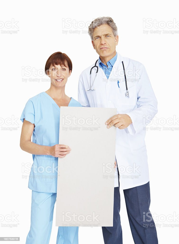 Portrait of a nurse and doctor in uniform holding placard royalty-free stock photo