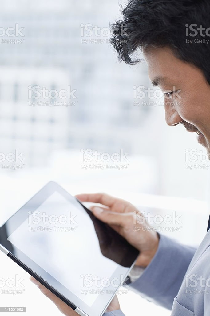 Portrait of a office worker using his tablet computer royalty-free stock photo