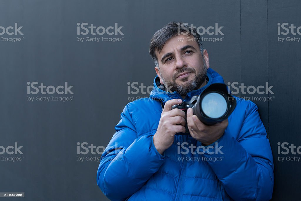 Portrait of a photographer looking away stock photo
