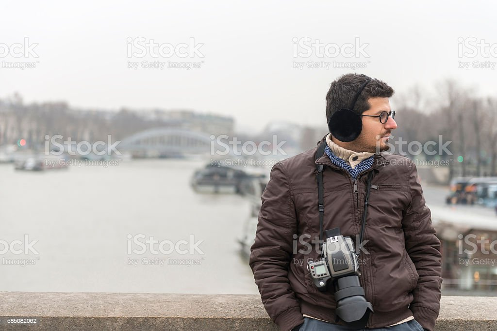 Portrait of a photographer man leaning on wall stock photo