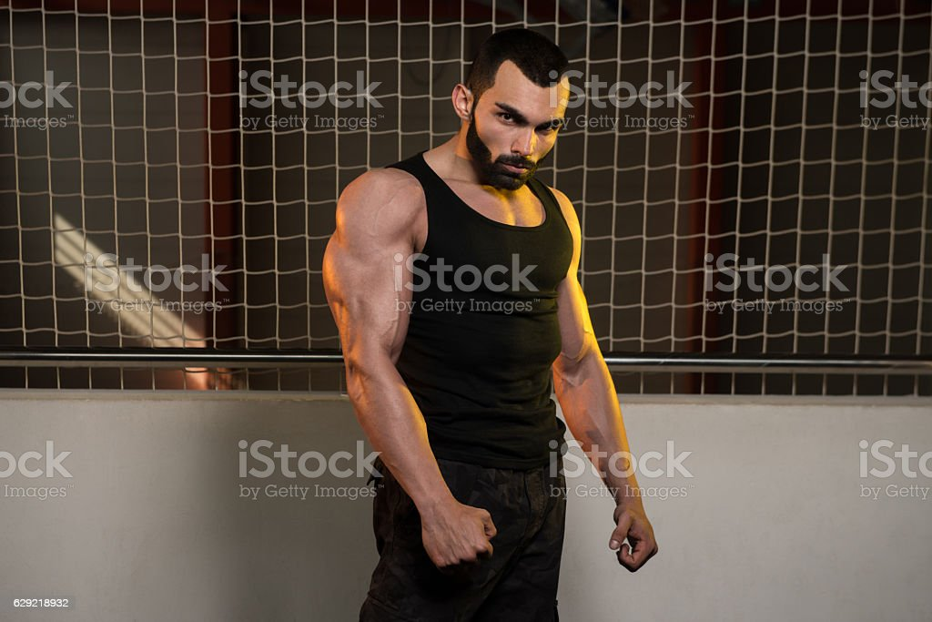 Portrait Of A Physically Man In Tank stock photo