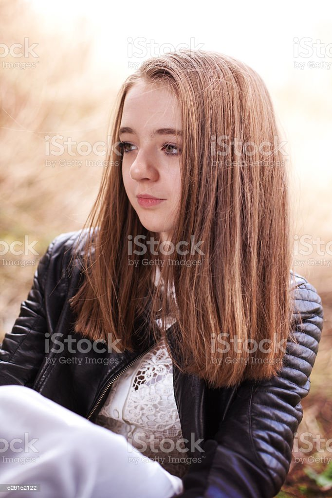 Portrait of a pretty teenage girl looking into the distance stock photo