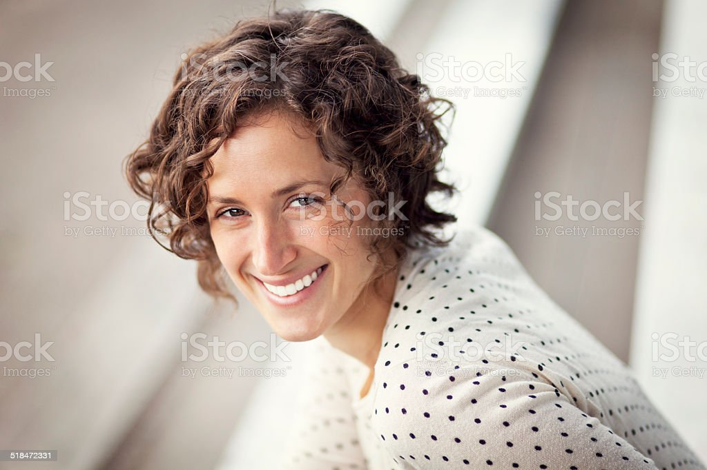 Portrait Of A Pretty Woman Smiling At The Park stock photo