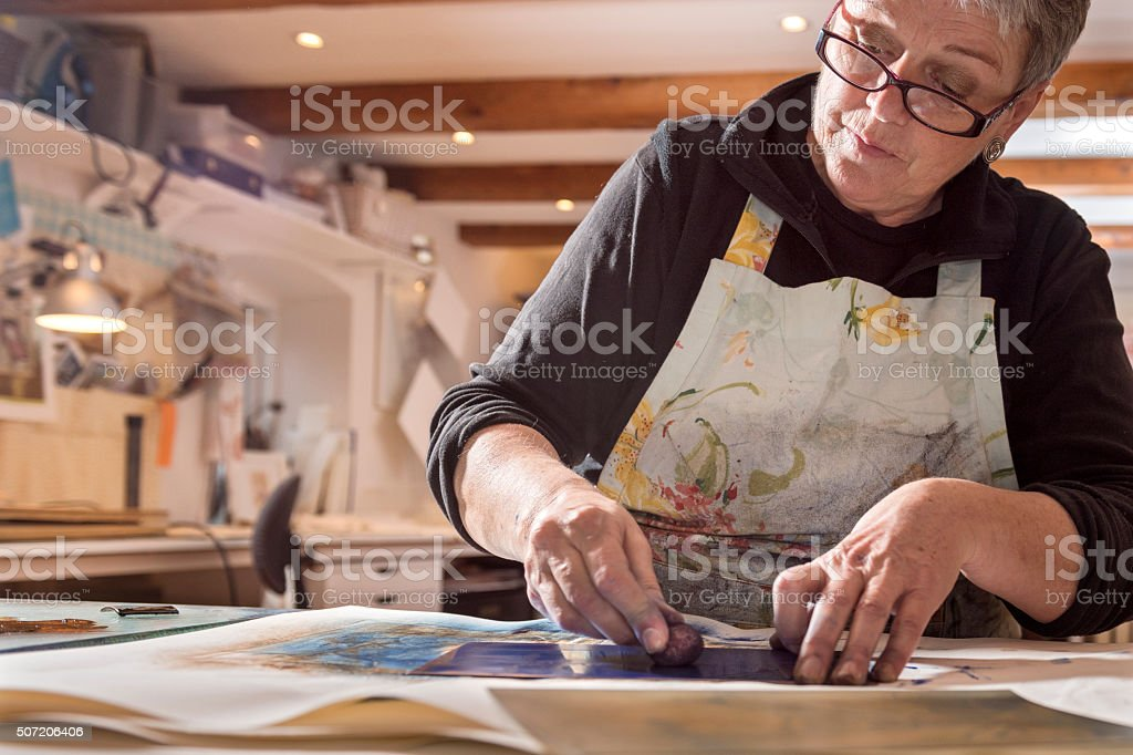 Portrait of a Printmaker Artist At Work stock photo