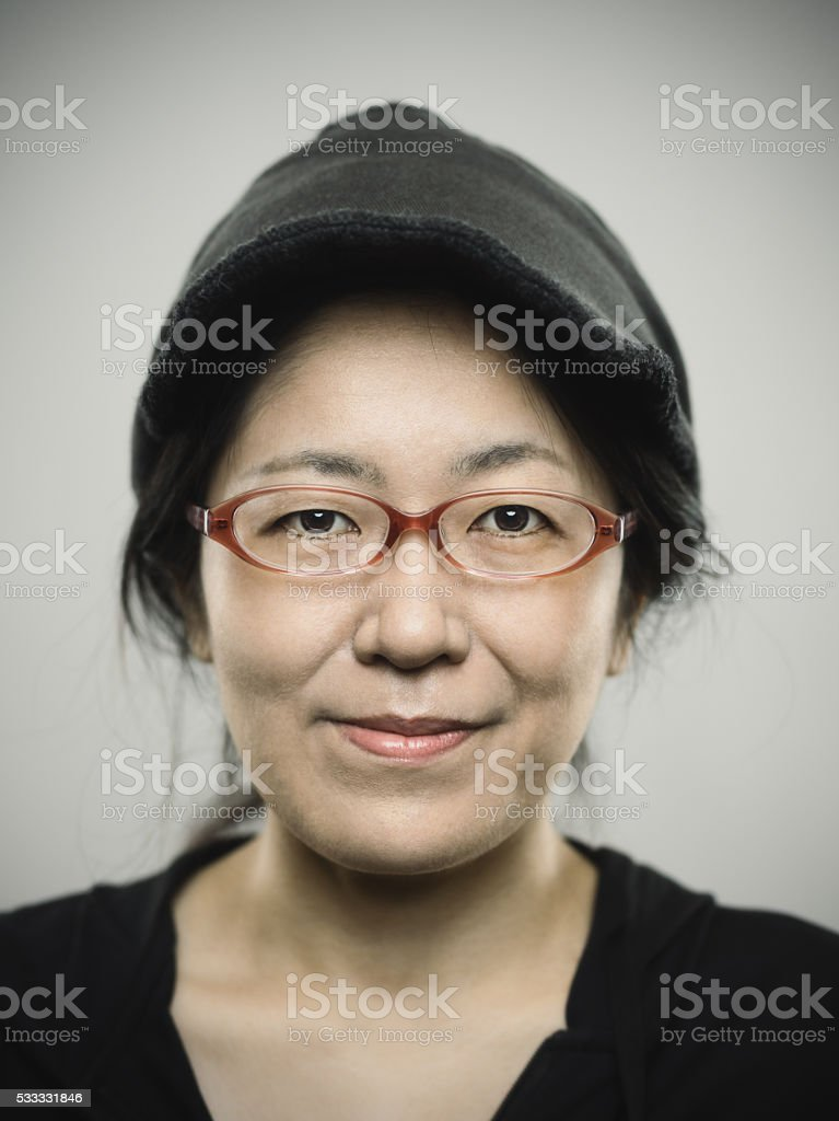 Portrait of a real adult japanese woman looking at camera stock photo