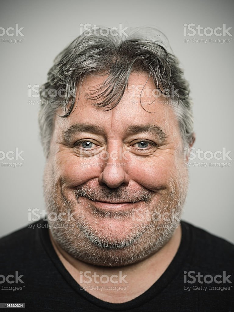 Portrait of a real happy english man looking at camera. stock photo