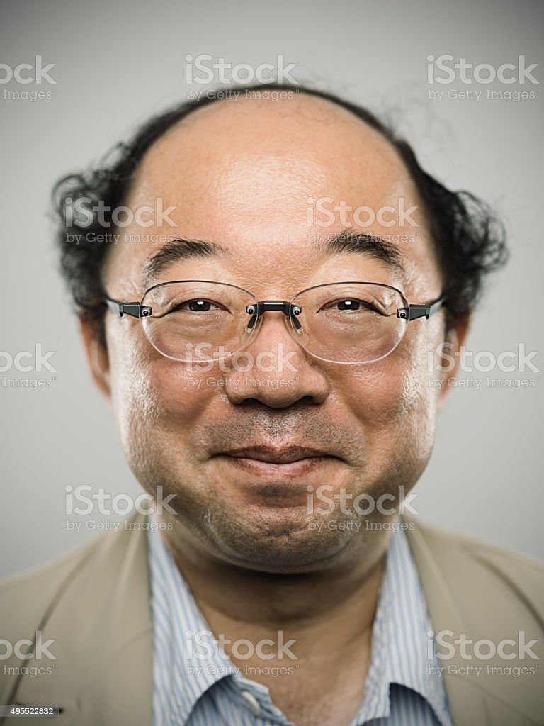 Portrait of a real happy japanese man with black hair. stock photo