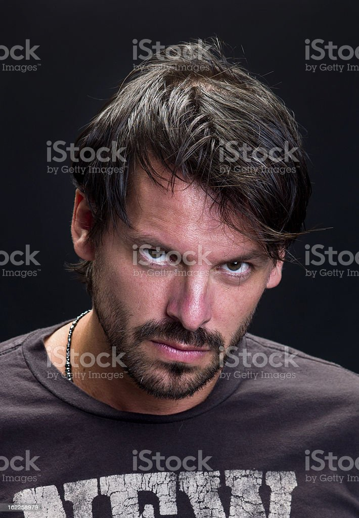 Portrait of a real man on black background. royalty-free stock photo