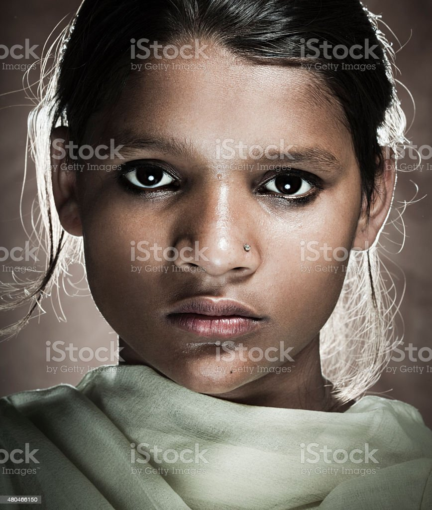 Portrait of a real rural girl of Indian ethnicity. stock photo