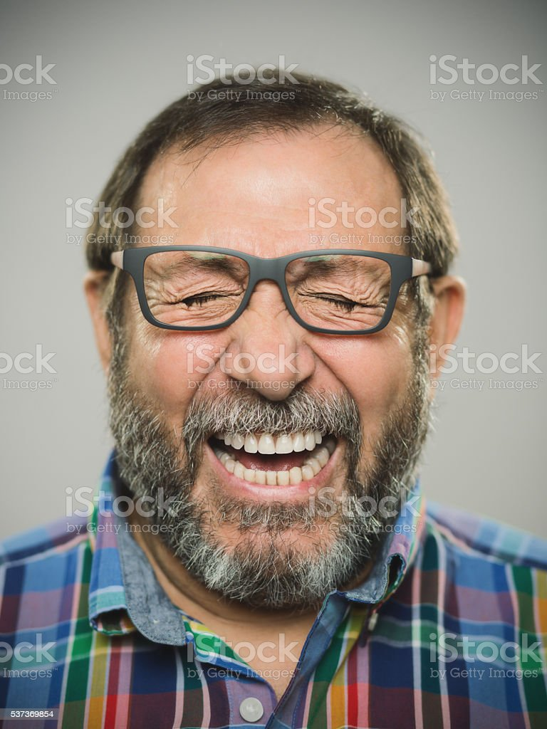 Portrait of a real spanish man with glasses and beard. stock photo