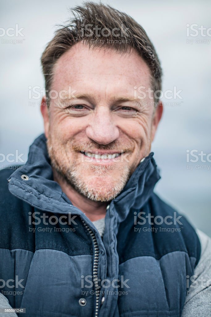Portrait of a relaxed mature man stock photo
