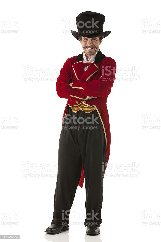 Portrait of a ring master standing with his arms crossed stock photo