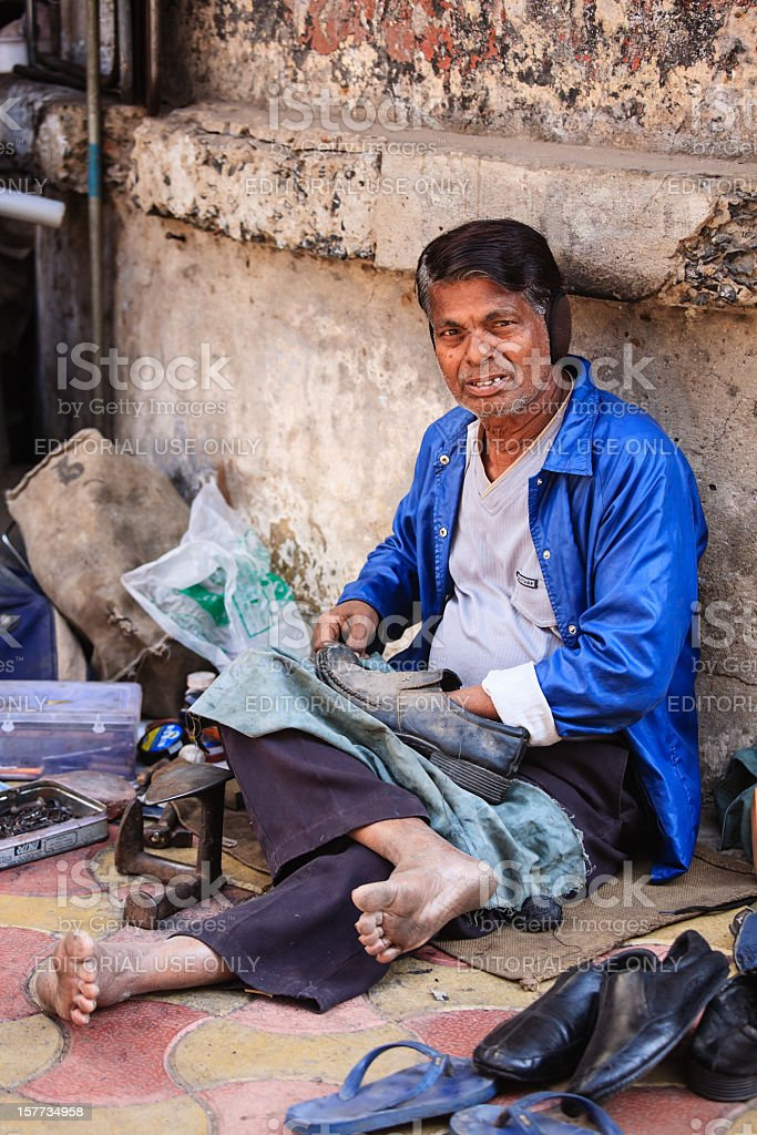 Portrait of a road side shoe maker looking at camera stock photo