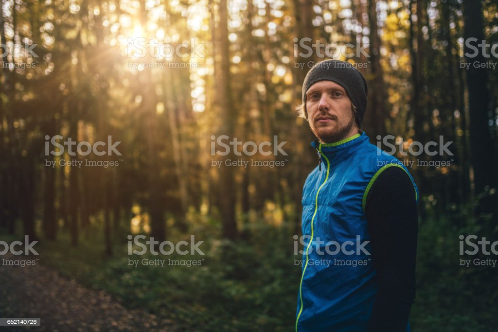 Portrait of a runner in a park on sunset stock photo