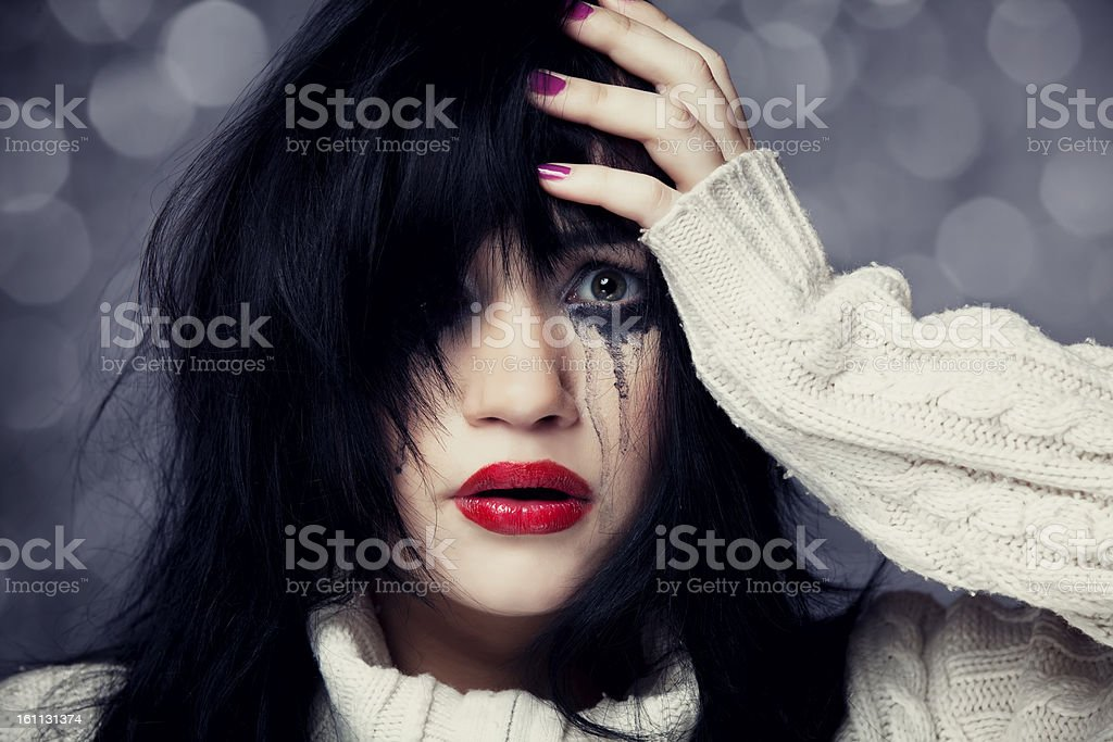 Portrait of a sad brunette. royalty-free stock photo