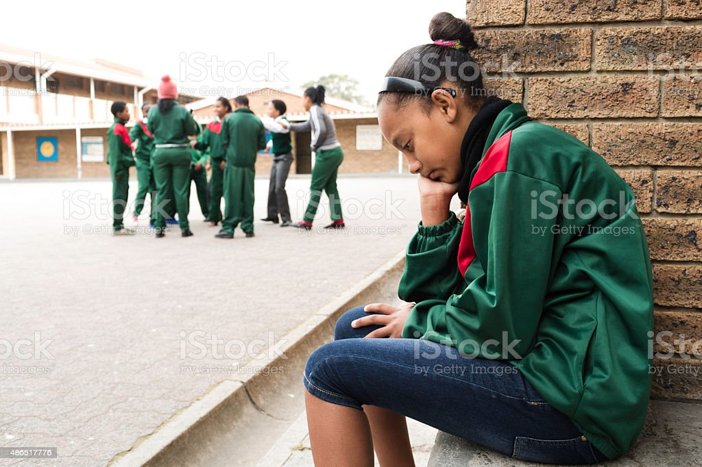 Portrait of a sad schoolgirl stock photo