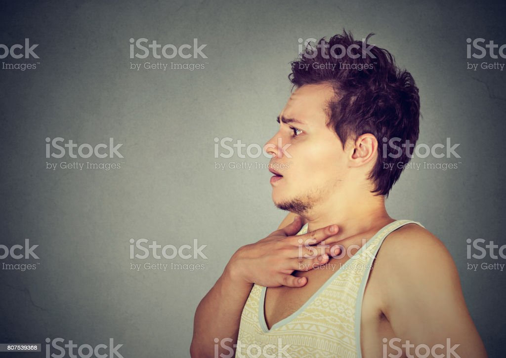Portrait of a scared anxious young man stock photo