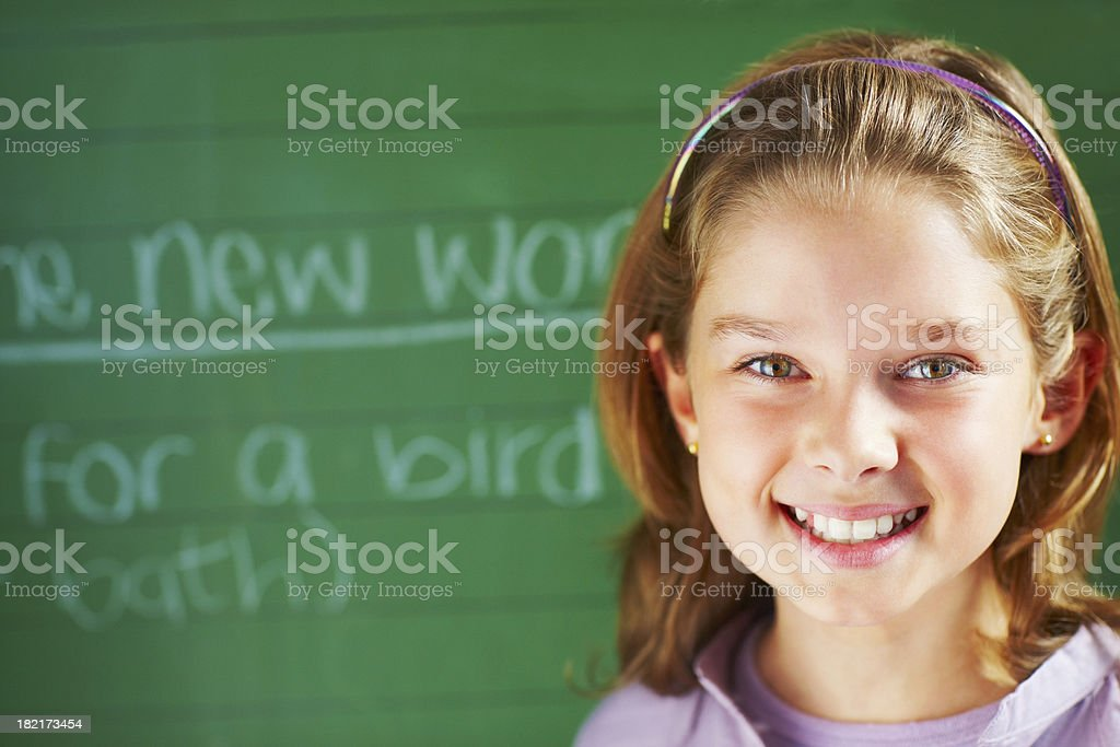 Portrait of a schoolgirl smiling royalty-free stock photo