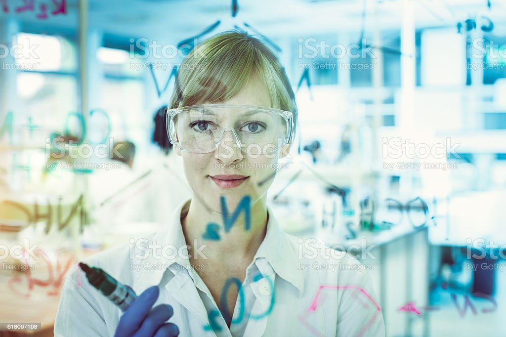 Portrait of a Scientist Writing a Chemical Bond stock photo