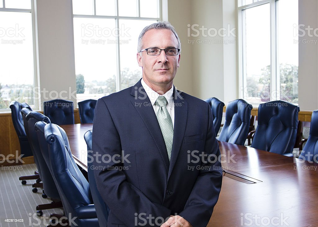 Portrait of a senior businessman in glasses stock photo