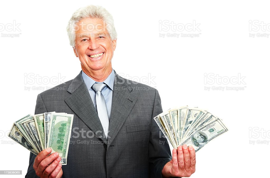 Portrait of a senior businessman showing dollars royalty-free stock photo