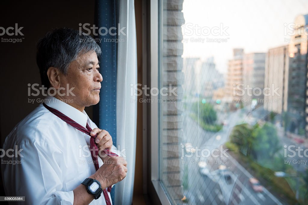 Portrait of a senior Japanese businessman stock photo