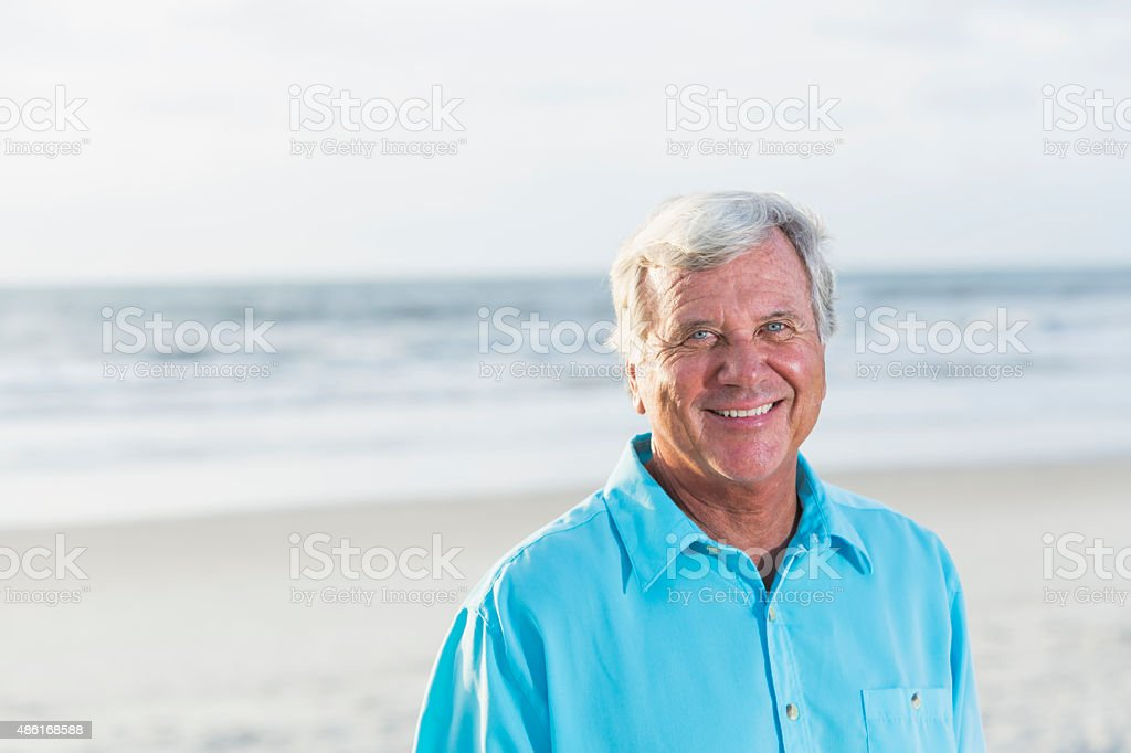 Portrait of a senior man at the beach stock photo