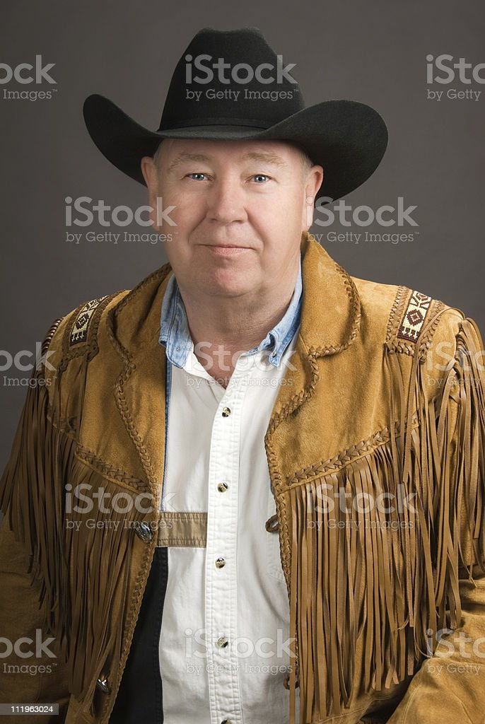 Portrait of a senior man in western outfit royalty-free stock photo