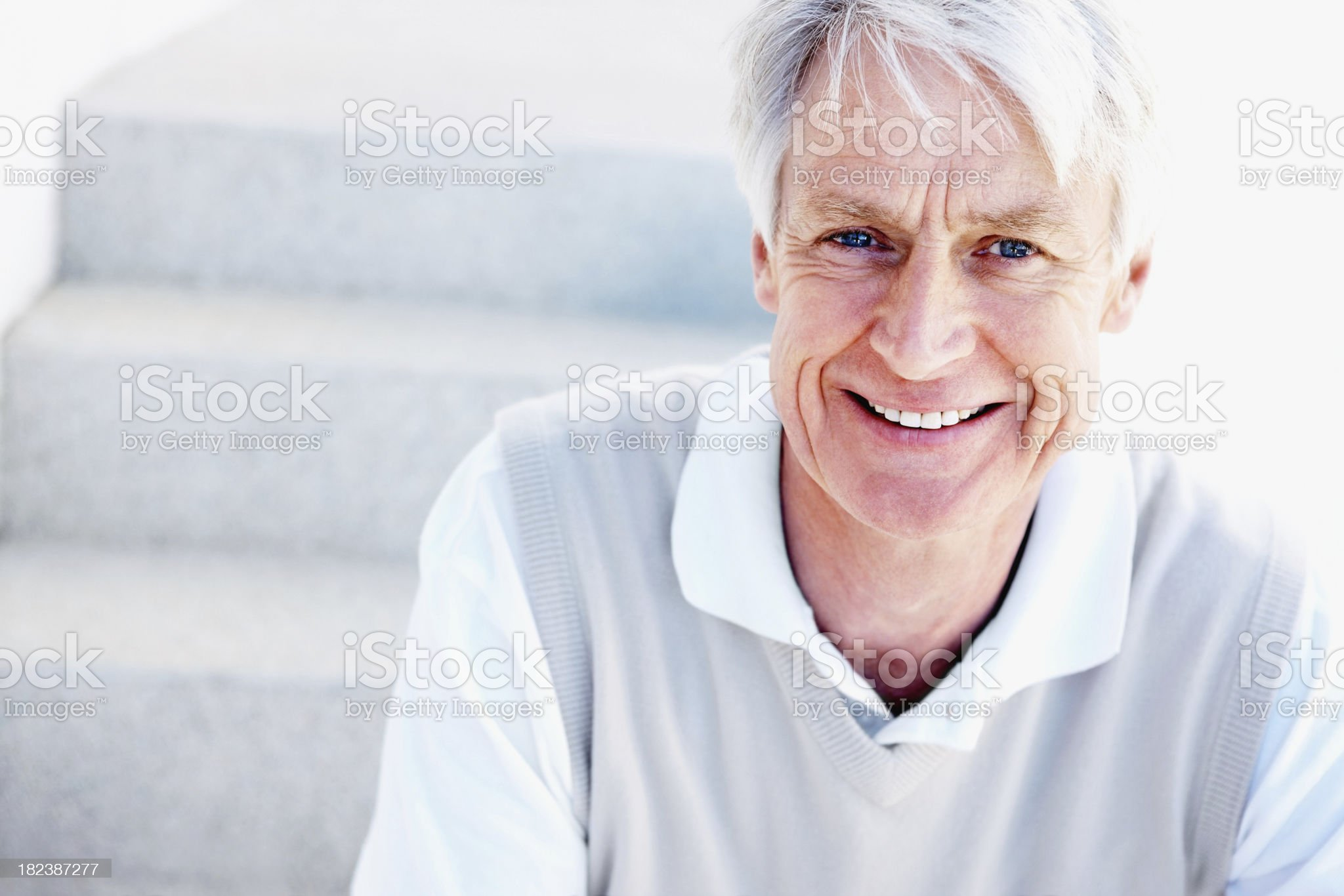 Portrait of a senior man smiling royalty-free stock photo