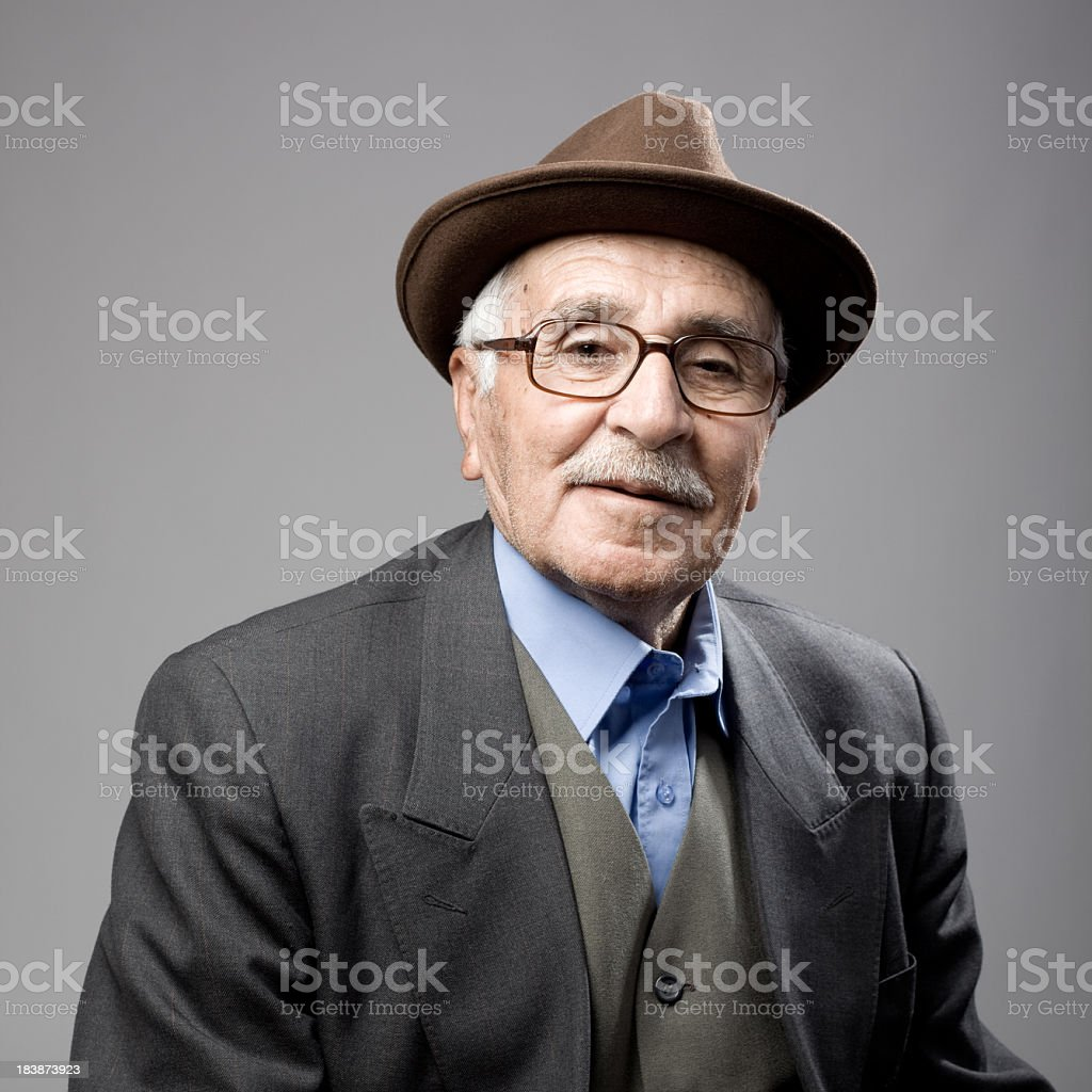 Portrait Of A Senior Man Wearing Fedora Hat And Jacket stock photo