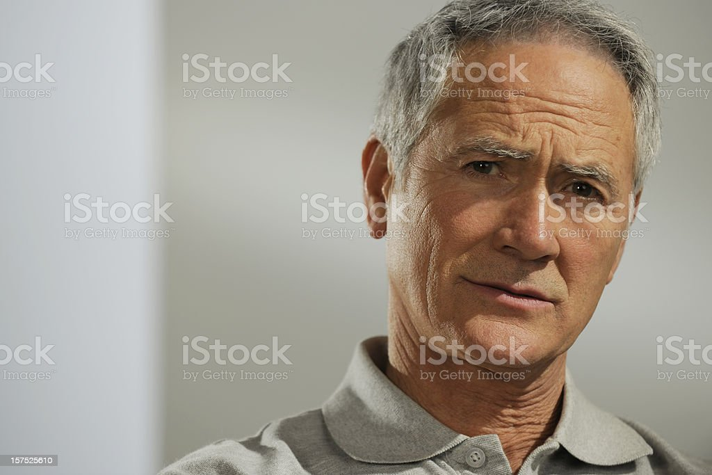 Portrait of a senior man with a concerned look on his face. royalty-free stock photo