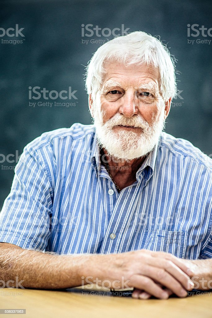 Portrait of a Senior man with white beard stock photo