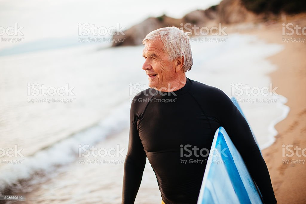 Portrait of a senior surfer stock photo