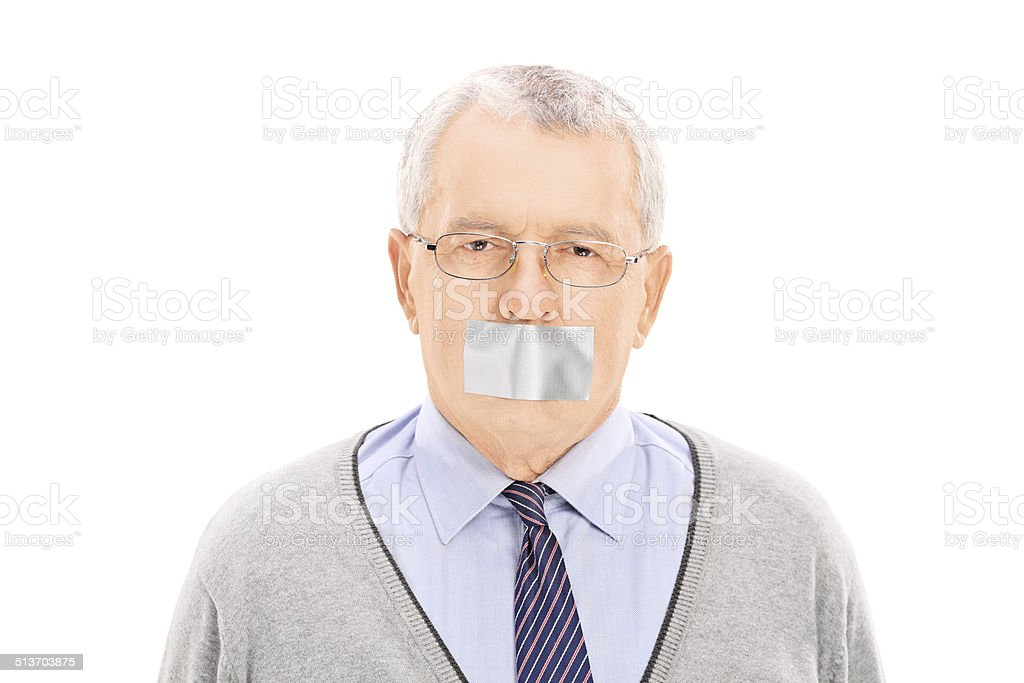 Portrait of a senior with duct taped mouth stock photo