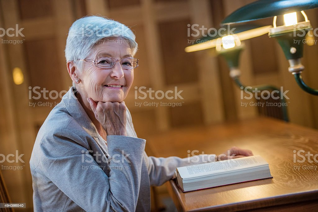 Portrait of a Senior woman in public library stock photo