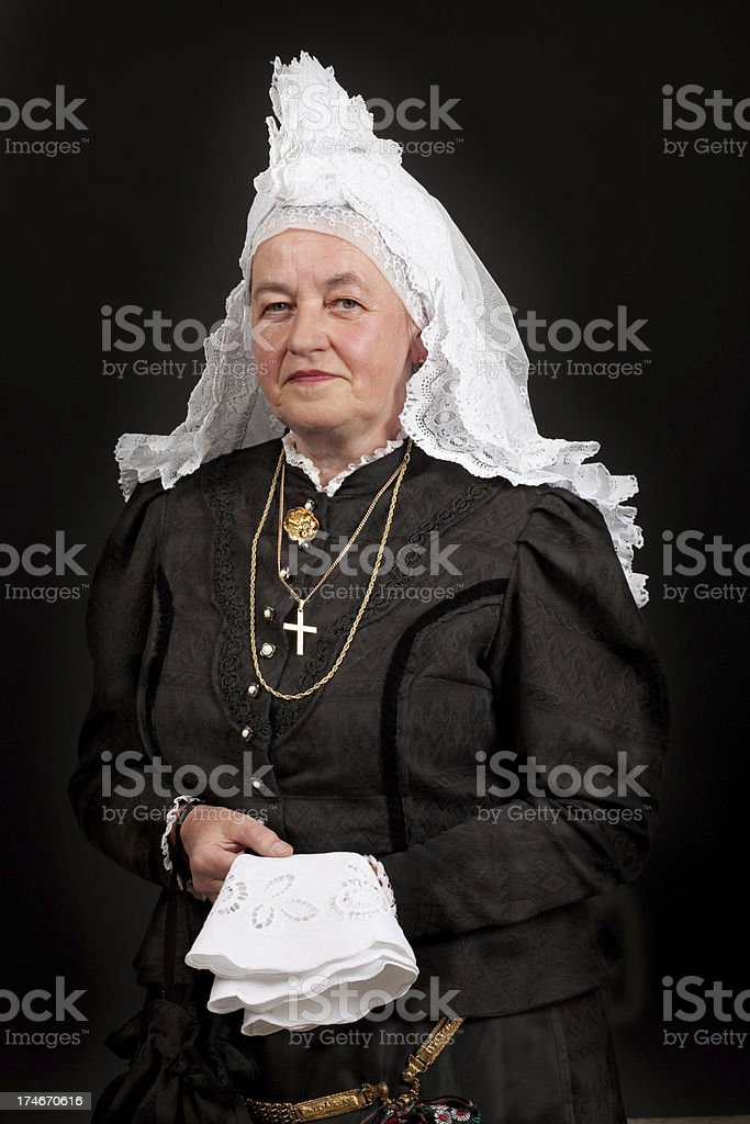 Portrait of a senior woman in the National clothing stock photo