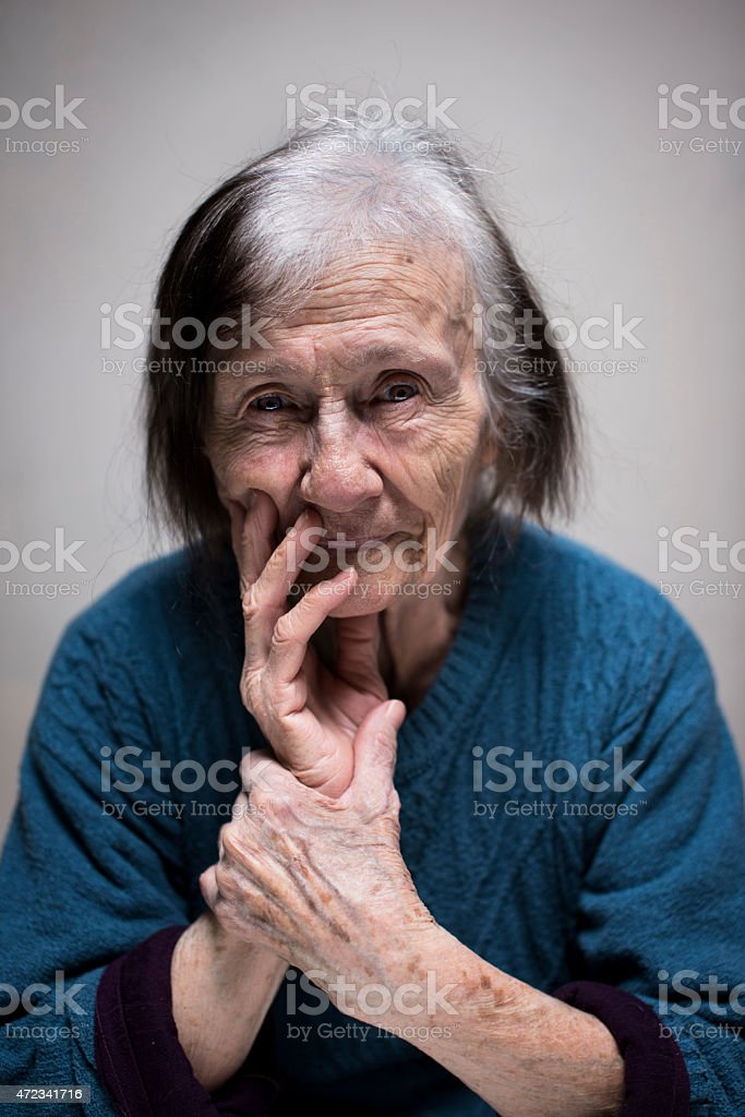 Portrait of a senior woman looking sad stock photo