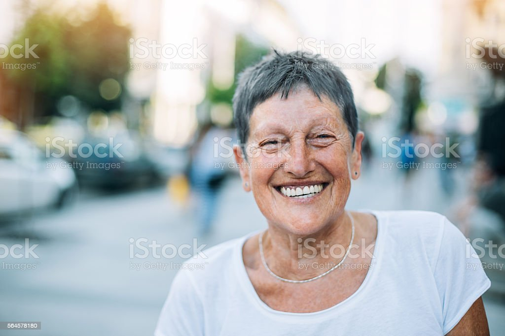 Portrait of a senior woman outdoors in the summer stock photo