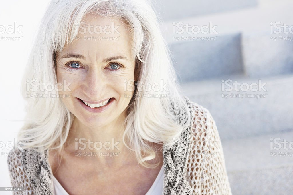 Portrait of a senior woman smiling royalty-free stock photo