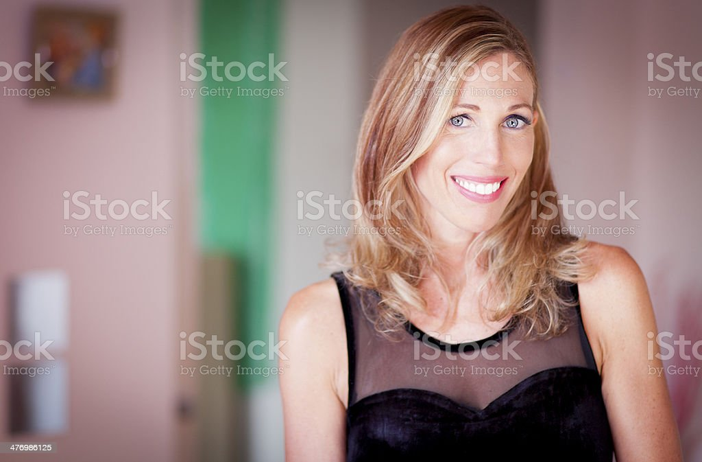 Portrait Of A Serene Classic Woman Smiling At The Camera royalty-free stock photo