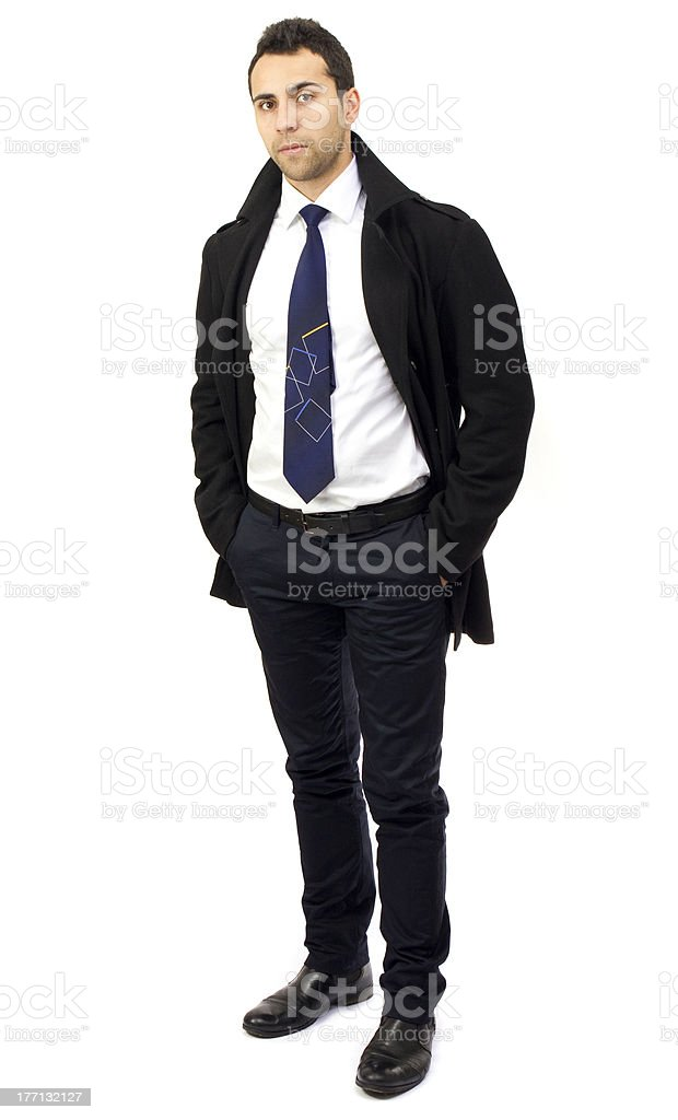 Portrait of a serious young businessman with hands in pockets royalty-free stock photo