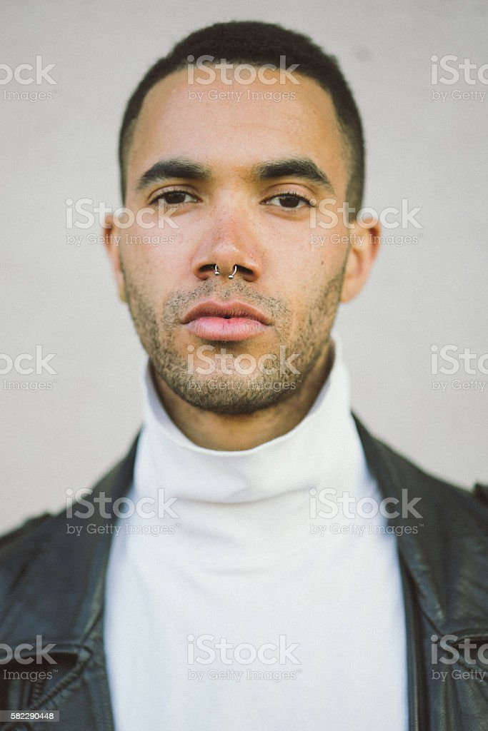Portrait of a serious young man stock photo