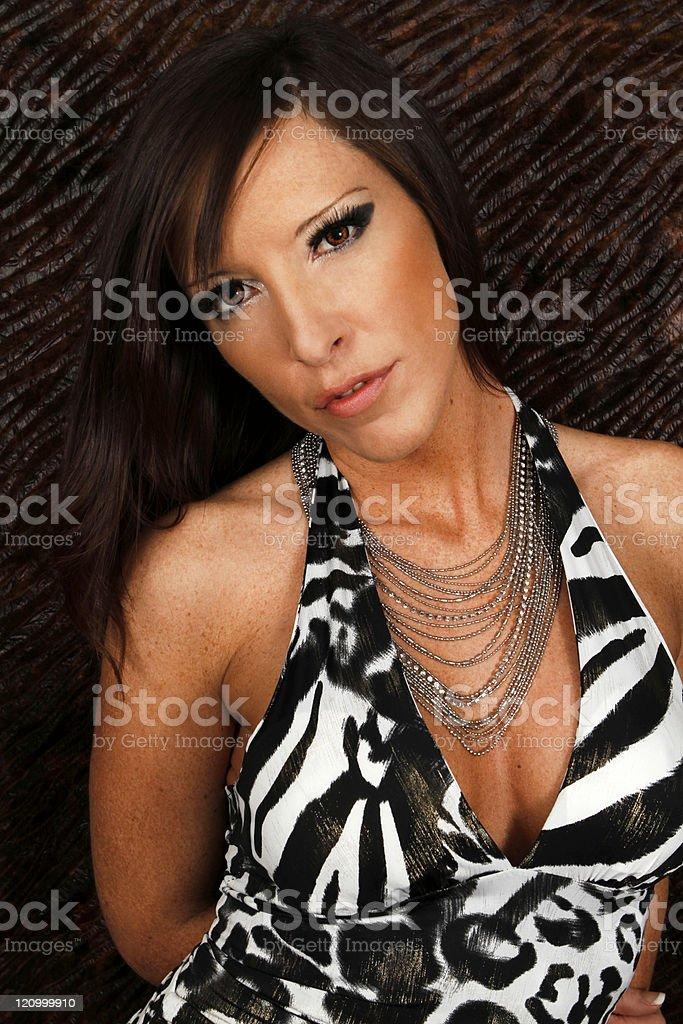 Portrait of a sexy lady in zebra dress stock photo