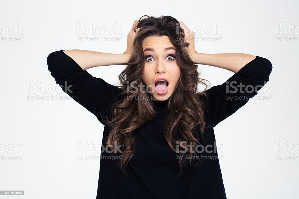 Portrait of a shocked woman with mouth open stock photo