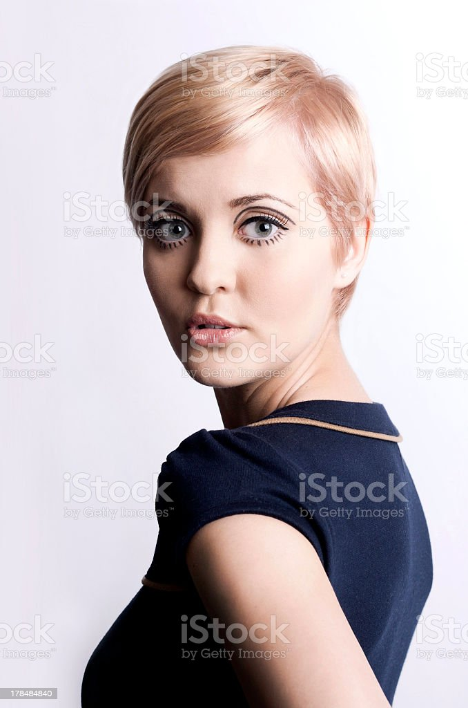 Portrait of a short haired retro style blonde woman stock photo