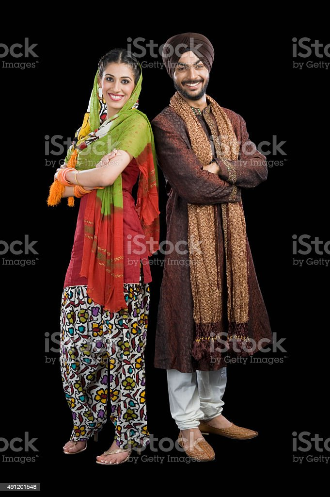 Portrait of a Sikh couple smiling stock photo