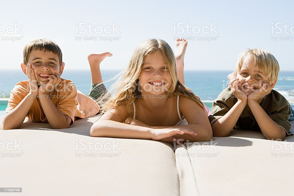 Portrait of a sister and her two brothers royalty-free stock photo