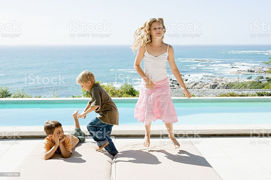 Portrait of a sister and two brothers royalty-free stock photo